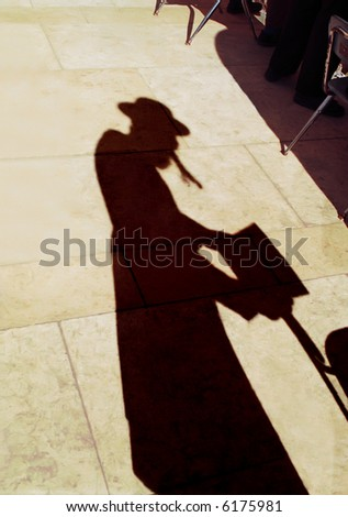 Shadow of the israelite of that being praying in western wall.