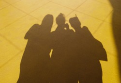 Shadow Of Three Asian Girls Group on The Yellow Floor, Concept Friends, Traveller, Hangout