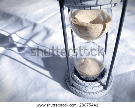 Shadow of time. Still life composition of hourglass and shadow.
