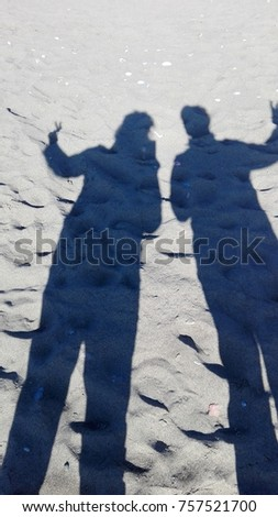 shadow of two persons on the beach #757521700