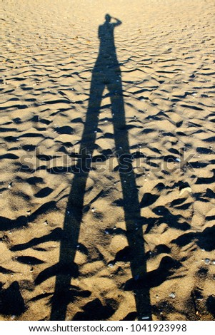 Shadow of unidentified person on a beach in Sifnos island, Greece
