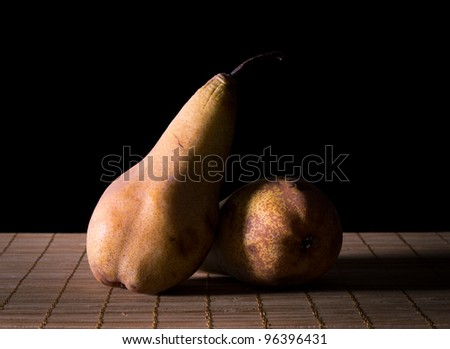 Shadow over two pears