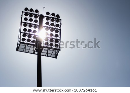 Shadow panels on large electrical poles are installed to illuminate the concert stage for safety and ease of supervision and control of the show. It also saves energy with new LEDs that use less power #1037264161