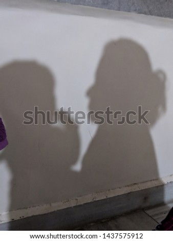 Shadow pic of mother caring her Child