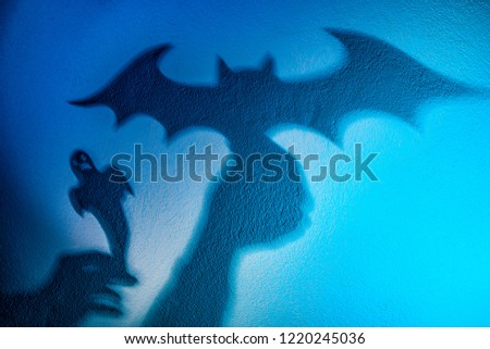 Shadow play. The shadow of a bat. Reflection shadows on the wall. Halloween Vampires. #1220245036
