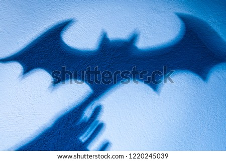 Shadow play. The shadow of a bat. Reflection shadows on the wall. Halloween Vampires. #1220245039