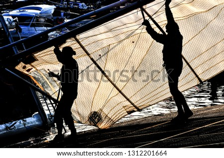 Shadow sailors silhoette picking sail #1312201664