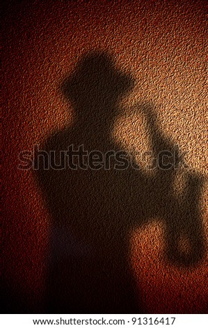 shadow saxophonist - stock photo