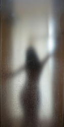 Shadow woman blur nude with water grain on mirror plate Backgrounds of bathroom