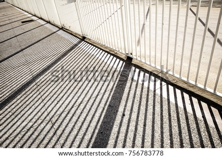 Shadows and lines in a parking in Marseille France #756783778