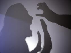 Shadows battered woman, gender violence and crime, symbol