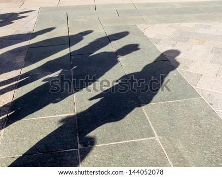 shadows of people, symbolic photo for anonymity, city life, mass society