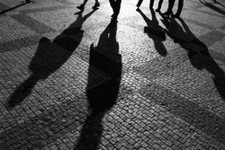 Shadows of people walking in a street of the city, Prague, September 2010.