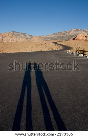 Shadows of Two People taking a Picture of a Scenic Drive