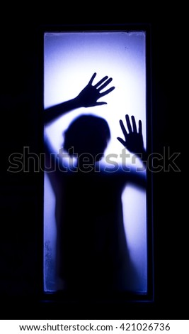 Stock Photo Shadowy figure behind glass.  Dramatic film grain