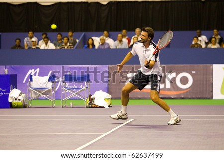SHAH ALAM, MALAYSIA - OCTOBER 8: Croatian Ivanisevic about to return a shot  at Showdown of Champions Tennis on October 8, 2010 in Shah Alam, Malaysia - stock photo