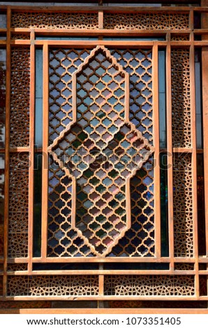 Shaki, Azerbaijan - August 13, 2017. Exterior view of stained-glass window with geometric patterns at the Palace of Shaki Khans, dating from 1762. #1073351405
