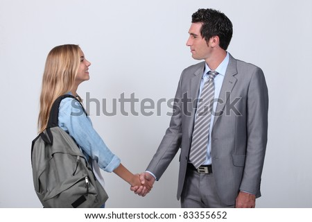 Businessman and teenage girl shaking hands Images and Stock Photos
