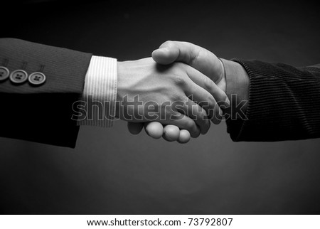 shaking hands in black and white
