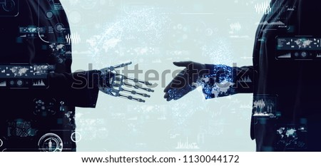 Shaking hands of a businessperson and a robot.