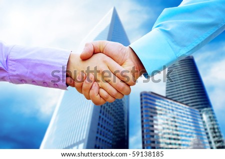 Shaking hands of two business people