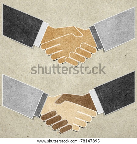 shaking hands  recycled paper craft stick on paper background