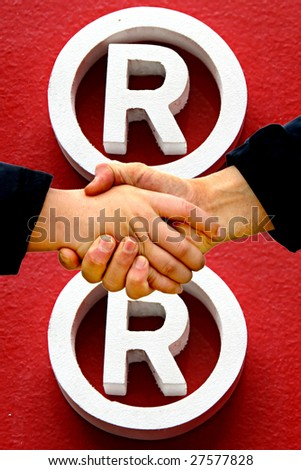 shaking hands - registered trademark symbol in background