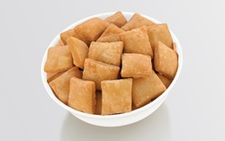 Shakkar pare Also Know as Shakkarpare, Shakarpare, Shakarpali, Shakkar Para, Sakarpara or Shankarpalli or shankar pale is a Snack Typically Made in India During Diwali - Image