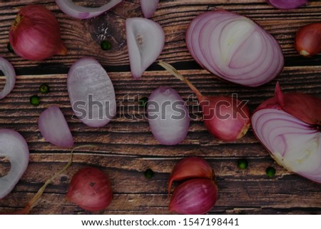 Shallots and spices on the wooden floor #1547198441
