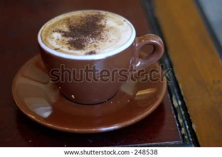 Shallow depth of field. Focus on chocolate powder in the middle of the cup.