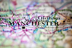 Shallow depth of field focus on geographical map location of Manchester city England United Kingdom Great Britain Europe continent on atlas