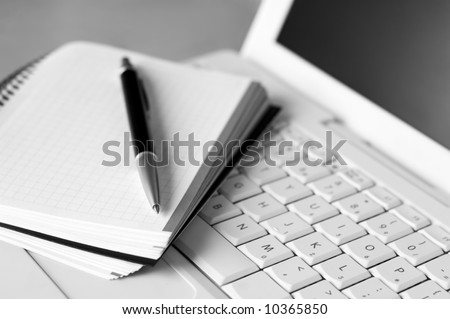 Shallow depth of field, focus on the tip of the pen and the area nears it