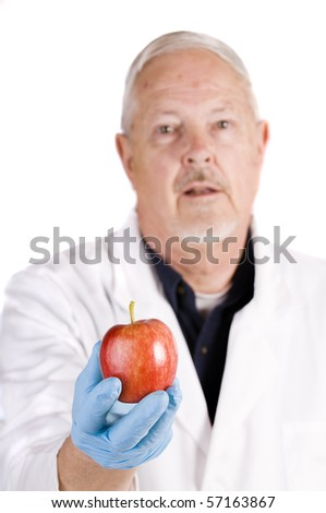 "shallow depth of field image of doctor or nurse offering patient an apple with instructions ""An apple a day keeps the doctor away"" :)"