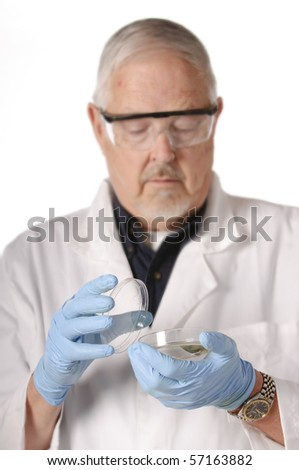 shallow depth of field of an older research scientist or doctor/nurse/technician looking at a culture dish for analysis