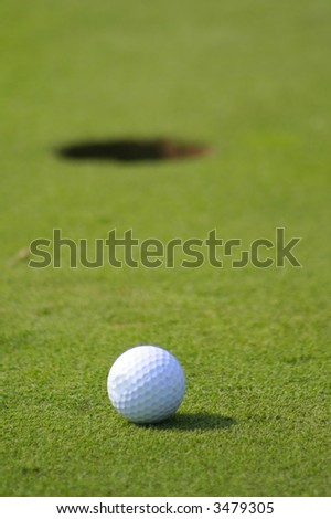 shallow depth of field of Golf ball on putting green,