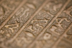 Shallow depth of field (selective focus) and close up footage with Egyptian hieroglyphs on a historic replica.
