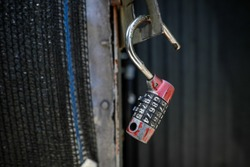 Shallow depth of field (selective focus) image with an open old cipher padlock.