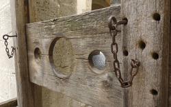Shallow depth of field shot of a pillory displayed in a museum