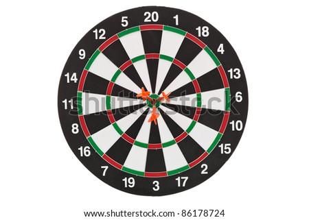 Shallow depth of field shot of darts in bullseye on dartboard