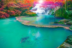 Shallow depth of field shot of Waterfalls in the emerald blue water in Erawan National Park. Erawan Waterfall is a beautiful natural rock waterfall in Kanchanaburi, Thailand.Onsen atmosphere