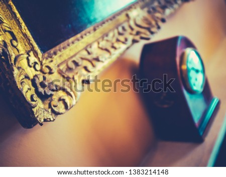 Shallow Focus Interior Detail Of An Ornate Picture Frame And Clock In An English Stately Home