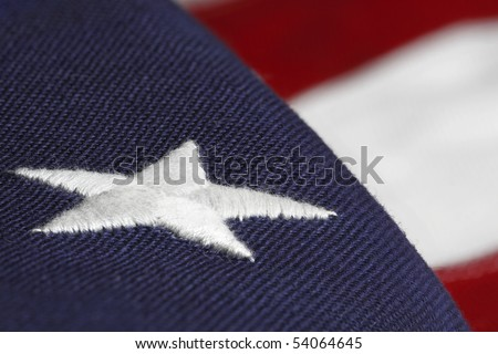 shallow focus of the american flag with an embroidered star