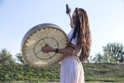 Shaman woman  drumming