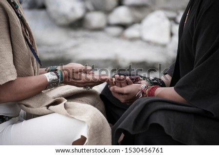 Shamanic blessing for a fruitful season. Man and woman in ceremony with indigenous corn.  #1530456761