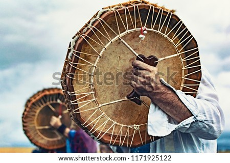 Shamanic drums in shamans hands. Ritual. Close