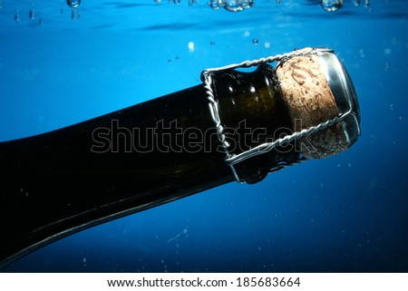 shampagne bottle neck on water with bubbles
