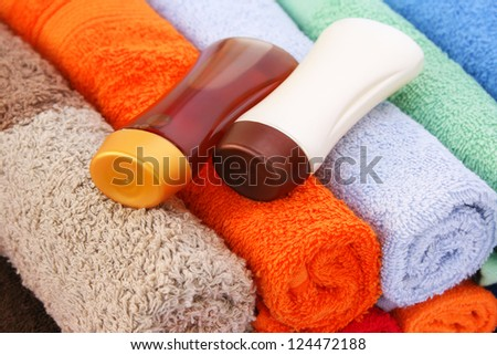 Shampoo bottles on colorful towels.