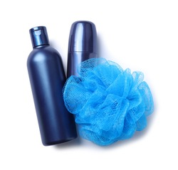 Shampoo, roller deodorant and bast wisp isolated on white, top view. Men's cosmetics