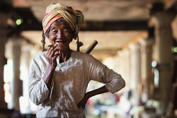 Shan State, Myanmar (Burma), happy old lady of Pa O ethnic minority smiling and smoking a Burmese cigar at Indein village near Inle Lake.
