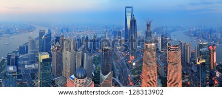 Shanghai aerial view with urban architecture and sunset panorama